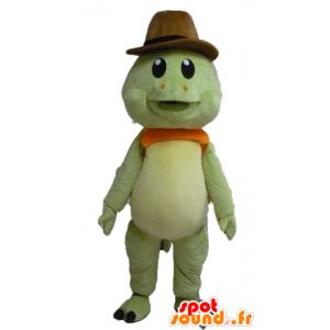 Maskot grønn skilpadde og oransje, med en cowboyhatt