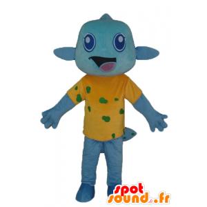 Blå fisk maskot, med en gul skjorte, veldig smilende