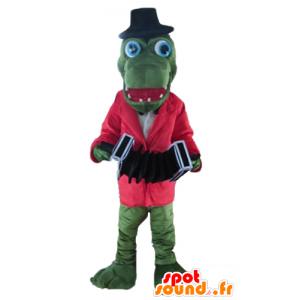 Zelený krokodýl maskot s červeným pláštěm a harmoniky