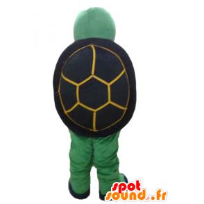Mascot geel groen en zwart schildpad, vriendelijk en glimlachend - MASFR24135 - Turtle Mascottes