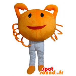 オレンジ色のカニのマスコット、巨人と笑顔