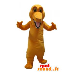 カラフルなオレンジ色のワニのマスコット、巨人、
