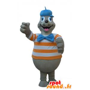 Mascotte lobo marino gris con una camisa a rayas de color naranja y blanco