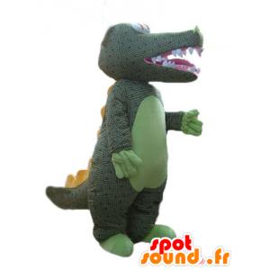 Vihreä krokotiili maskotti kanssa harmaan sävyt