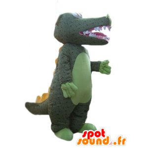 Zielony krokodyl maskotka z szarości