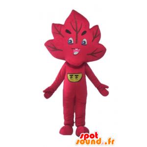 Mascotte de feuille rouge, géante et souriante
