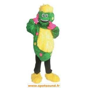 Mascot monstro engraçado, verde e amarelo
