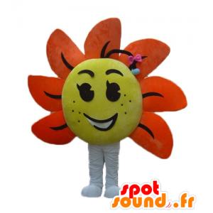 Mascot gigantische bloem, geel en oranje