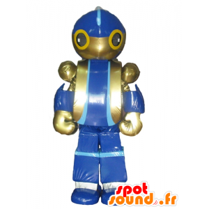 Mascotte de robot, de jouet bleu et doré, géant