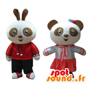 2 maskotar, en kanin och en panda, brun och vit, leende -