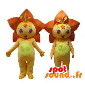 2 mascotes de laranja e flores amarelas, lírios