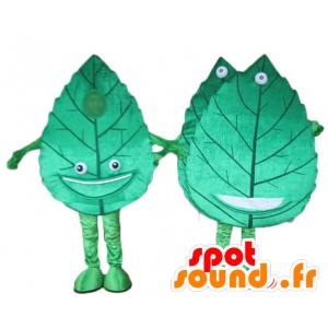 2 mascotte giganti e foglie verdi sorridenti