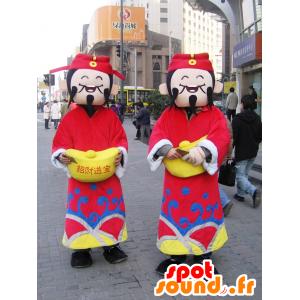 2 japanska maskotar från Shanghai i traditionell klädsel -