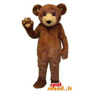 La mascota del oso marrón y beige, suave y peludo
