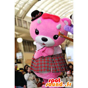 Mascot pink and white teddy with a kilt