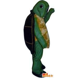Mascot verde y amarillo con un caparazón de tortuga negro