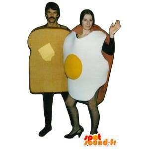 2 maskoter, et stekt egg og brød smørbrød