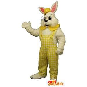 Rabbit maskot med briller, gul kjeledress