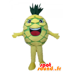 Mascot gigante amarilla y verde piña. fruto de la mascota