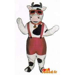 Vaca mascote preto e branco com um macacão vermelho
