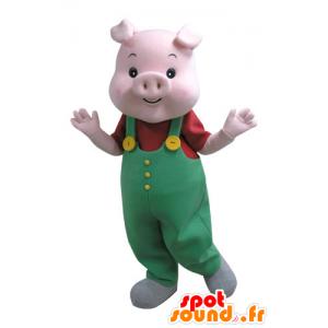 Rosa Schwein-Maskottchen mit einem grünen Overall - MASFR031125 - Maskottchen Schwein