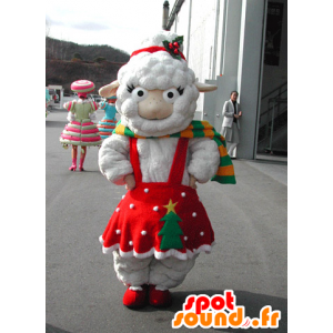 λευκό μασκότ προβάτων ντυμένη με ένα κόκκινο Χριστούγεννα φόρεμα