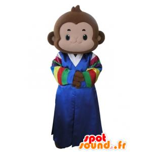 Brun ape maskot kledd i en flerfarget kjole - MASFR031633 - Monkey Maskoter