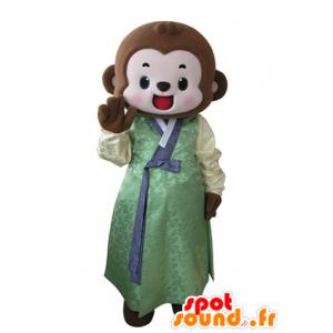 Marrone scimmia mascotte vestita di una tunica gialla e verde - MASFR031636 - Scimmia mascotte