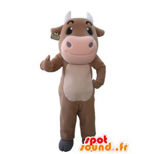 Obří hnědá a růžová kráva maskot