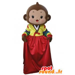 Mascotte scimmia marrone con un abito colorato