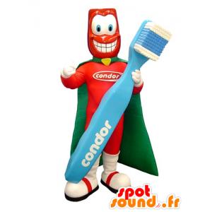 Mascote super-herói com uma escova de dentes gigante