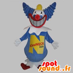Blauwe en witte clown mascotte met een grote glimlach