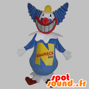 Niebieski i biały clown maskotka z wielkim uśmiechem