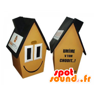 Gule huset maskot, brunt og svart, veldig smilende
