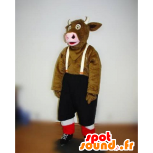 Mascotte de vache marron avec un short à bretelles
