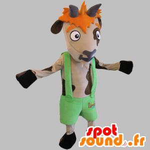 Mascotte de vache marron et beige avec un short à bretelles