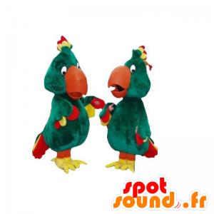 2 Maskottchen von grünen Papageien, gelb und rot