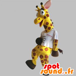 Maskotti keltainen ja ruskea kirahvi, jättiläinen ja hauska