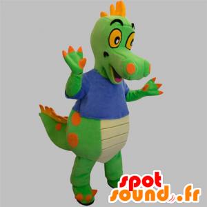 Grønn og oransje dinosaur maskot med en blå skjorte
