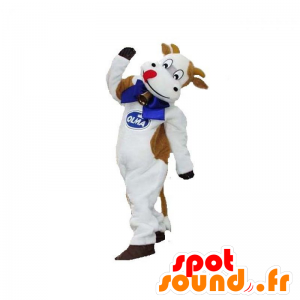 λευκό και καφέ αγελάδα μασκότ με ένα κουδούνι