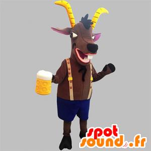 La mascota de cabra marrón con cuernos amarillos