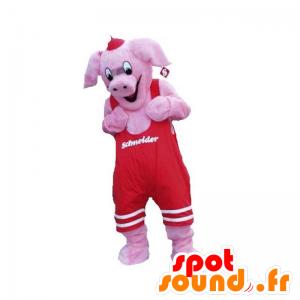 Mascote porco cor de rosa com um macacão vermelho - MASFR031919 - mascotes porco