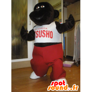 Dark brown gorilla mascot with a red and white outfit