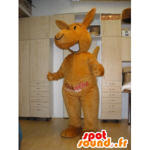 Mascotte de kangourou orange, géant et souriant