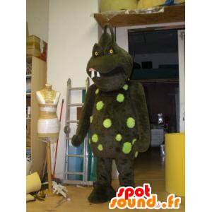 Mascot brunt og grønt monster, skremmende