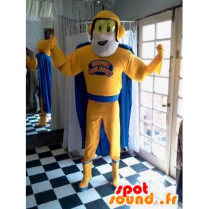 Superheld Maskottchen hält gelb und blau