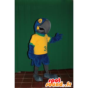 Mascotte de perroquet bleu et jaune avec un maillot brésilien