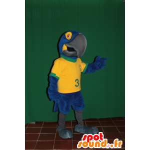 Blauwe en gele papegaai mascotte met een Braziliaanse jersey