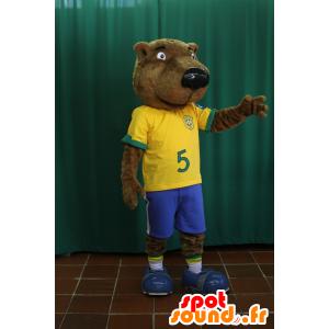 Mascotte de castor, d'ours marron en tenue de footballeur