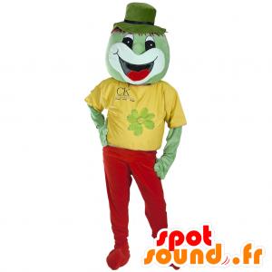 赤と黄色の服を着て緑のクリーチャーのマスコット、笑顔、 - MASFR032183 - マスコットモンスター